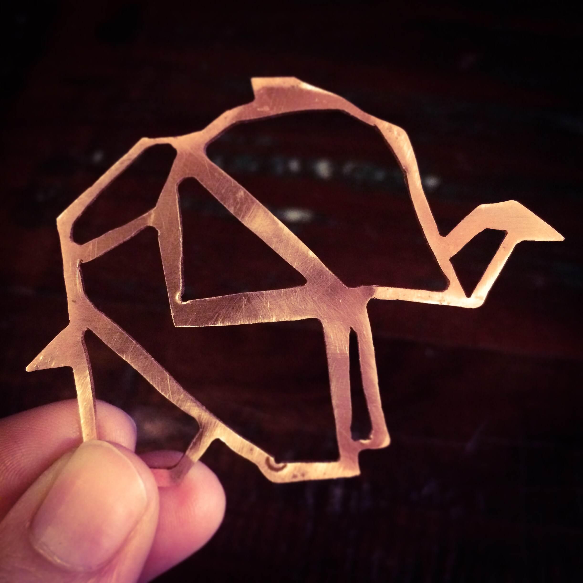 Hand sawn copper origami elephant